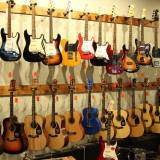 Danche-Guitars-on-Wall-11